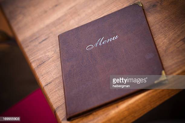 leather-bound menu at european cafe - menu stock pictures, royalty-free photos & images