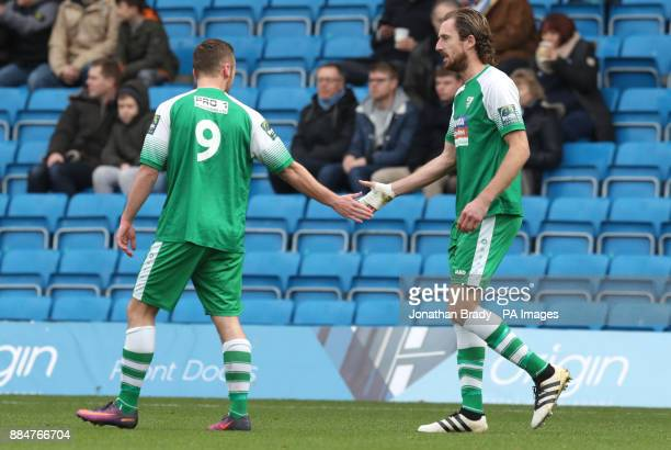 Leatherhead's Jack Midson is congratulated by Niall McManus after scoring the opening goal during the Emirates FA Cup second round match at Adams...