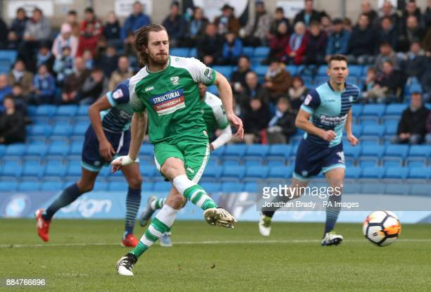 Leatherhead's Jack Midson scores the opening goal from the penalty spot during the Emirates FA Cup second round match at Adams Park Wycombe