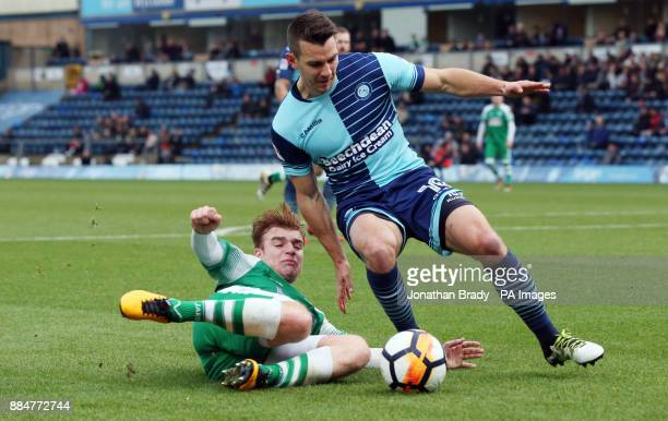 Leatherhead's Sam Blackman tackles Wycombe Wanderers' Matt Bloomfield during the Emirates FA Cup second round match at Adams Park Wycombe
