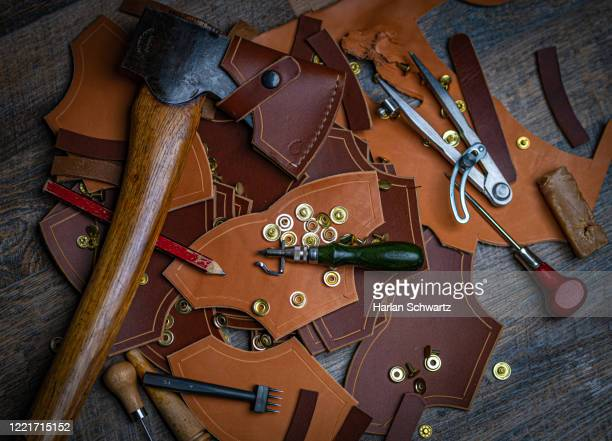 leatherwork scene - dagger stock pictures, royalty-free photos & images