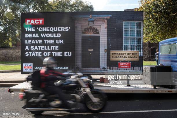 A 'Leave Means Leave' campaign billboard urging British Prime Minister Theresa May to scrap her Chequers Brexit proposal is driven around Westminster...