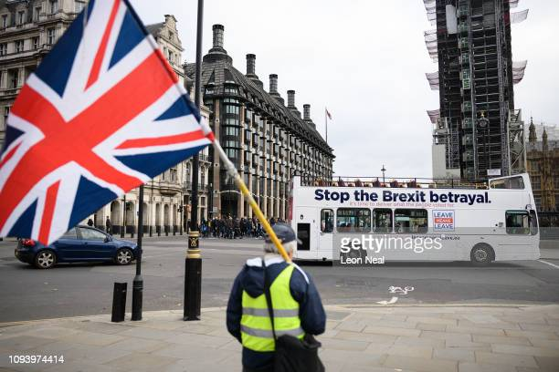 A Leave Means Leave campaign bus drives outside the Houses of Parliament calling for the Government to respect the Brexit decision and leave the EU...