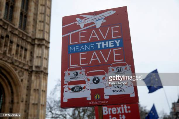 A 'Leave Means Leave' sign the Houses of Parliament with reference to the car manufacturer Honda who announced today that they are to close their...