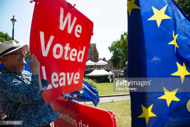 A leave supporter holds a placard on College Green opposite the Houses of Parliament following the announcement that Boris Johnson will be the new...