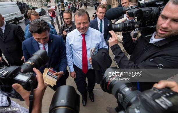 LeaveEU backer Arron Banks arrives alongside Andy Wigmore to give evidence to the fake news select committee at Portcullis House on June 12 2018 in...