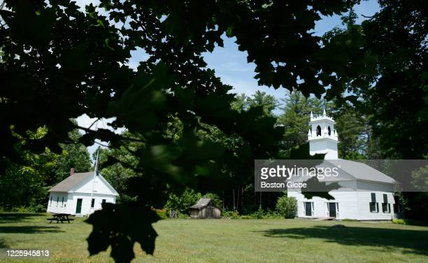 Leaves frame the Bradford Center Meeting House in the small town in Bradford, NH on July 7, 2020. Maxwell was arrested on charges that she helped...