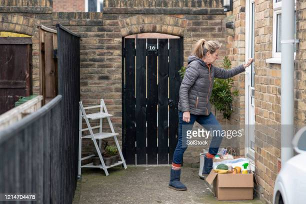 leaving a box of goods - assistance stock pictures, royalty-free photos & images