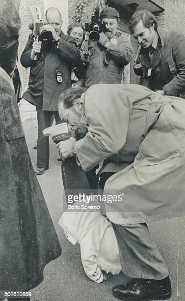 Leaving a polling station in Ottawa today after voting Prime Minister Pierre Trudeau first swings his son Justin 10 months old high in the air then...