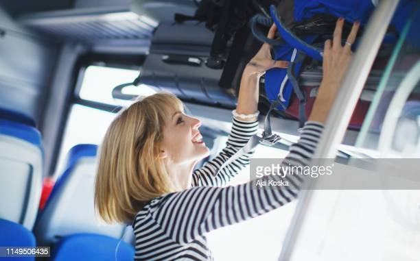 leaving bag on the luggage rack. - luggage rack stock photos and pictures