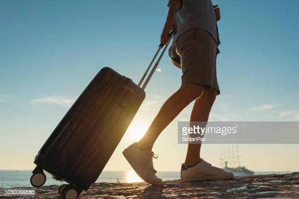 leaving everything behind - wheeled luggage stock photos and pictures