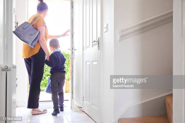 leaving for his first day of school - leaving stock pictures, royalty-free photos & images