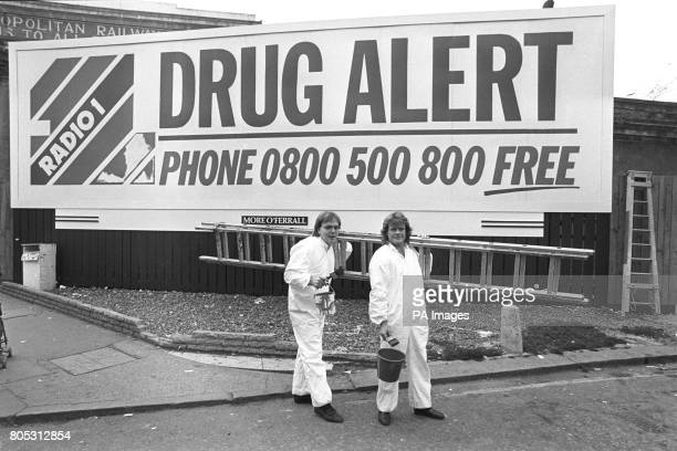 Leaving Gloucester Road tube station in London today Radio One disc jockeys Adrian John and Bruno Brookes after pasting up their eyecatching poster...
