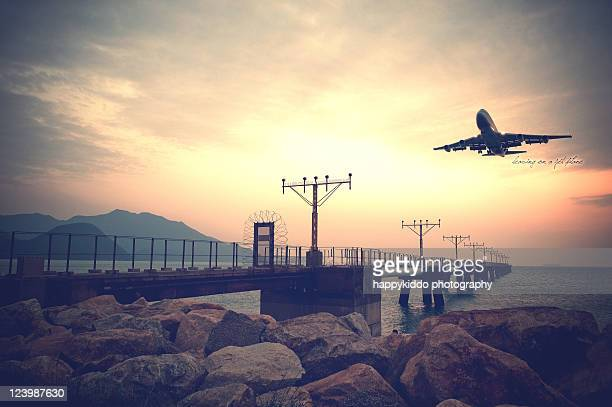leaving on jet plane - hong kong international airport stock photos and pictures