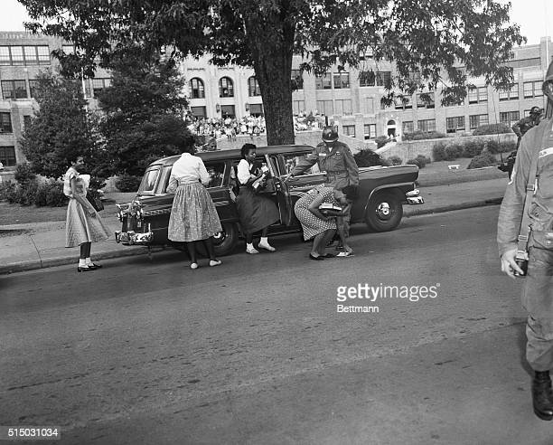 Leaving the Army Vehicle that brought the nine black students to Little Rock Central high School this morning Minnie Brown dropped a book That was...