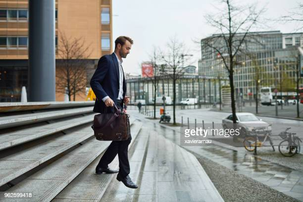 leaving the office - mid adult men stock pictures, royalty-free photos & images
