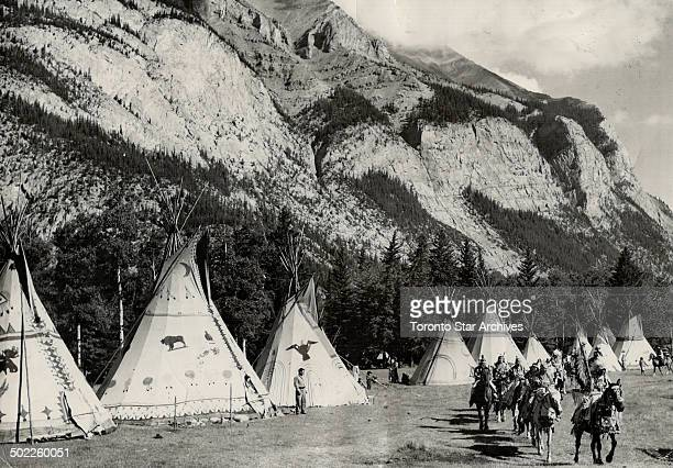 Leaving their Teepee camp at Banff for their parade through the Alberta foothills city are members of Stoney Sarcee and Blackfoot tribes taking part...