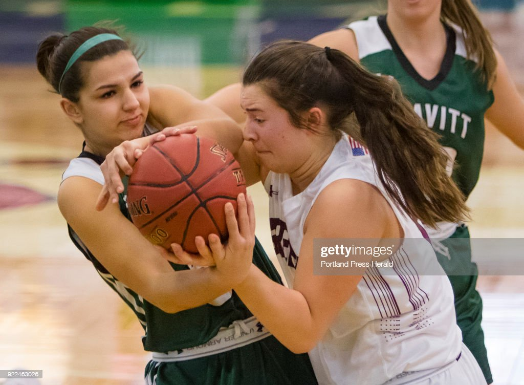 Leavitt forward Becca Fogg and Greely forward Emma Spoerri wrestle for the ball during girls Class A South quarterfinals on Monday, February 19, 2018 at the Portland Expo.