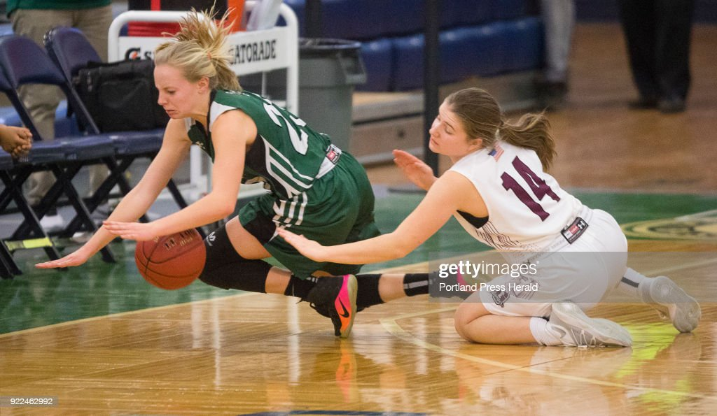 Leavitt guard Taylor White and Greely guard Kelsea Currier during the girls Class A South quarterfinals on Monday, February 19, 2018 at the Portland Expo.