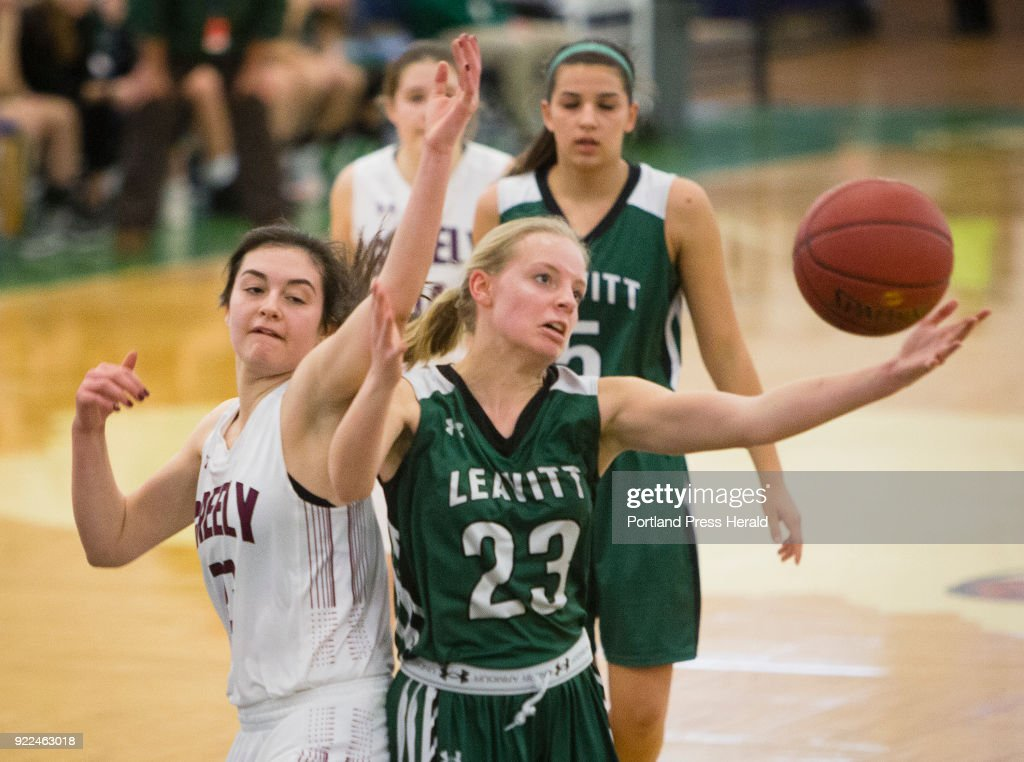 Leavitt guard Taylor White (R) controls the rebound as Greely forward Jenifer Spencer comes up empty during the girls Class A South quarterfinals on Monday, February 19, 2018 at the Portland Expo.