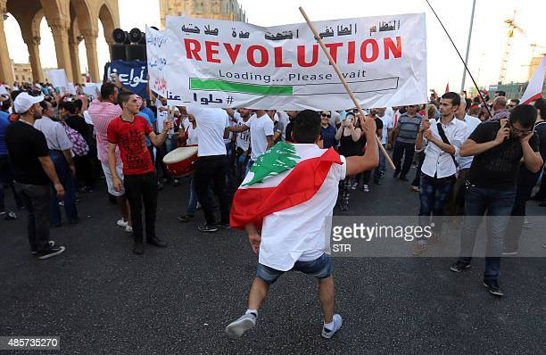 Lebanese activists hold a placard as they gather during a mass rally against a political class seen as corrupt and incapable of providing basic...
