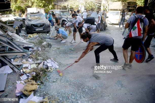 Lebanese activists take part in a campaign to clean the damaged neighbourhood of Gemmayze on August 5 a day after a blast in a warehouse in the port...