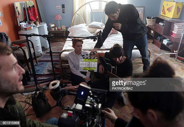 Lebanese actress Reine Salameh and actor Walid Feghali rehearse on the set of Lebanese director Nadim Tabet's new movie on December 14 2015 in the...
