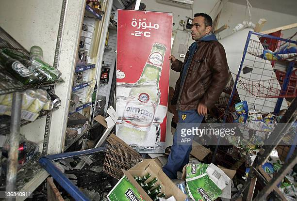 Lebanese Ahmad Ali Hamdan inspects damages at his liquor store following a bomb blast in the southern Lebanese town of Sarafand on January 12 2012 A...