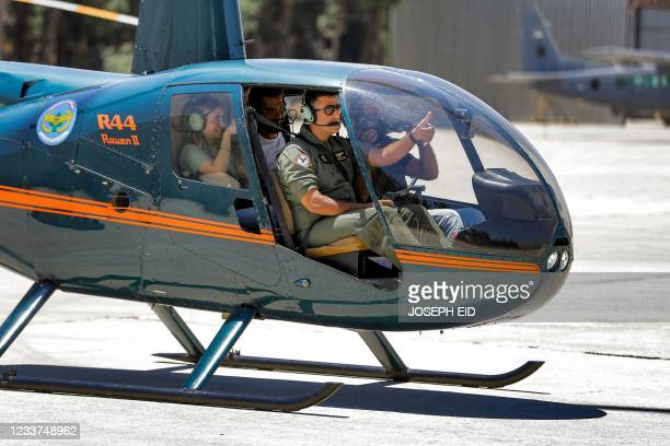 Lebanese Air Force Robinson R44 Raven II helicopter takes off with journalists during a press tour at Rayaq military air base in the Bekaa Valley on...