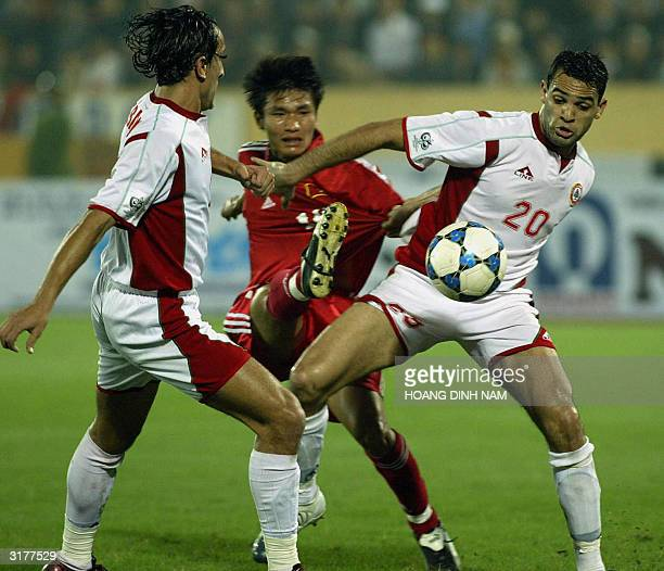 Lebanese Ali Nasseredine and Rodar Antar fight for baloon with Vietnamese Le Hong Minh during a qualyfying football match between Vietnam and Lebanon...