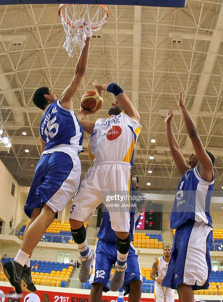 Lebanese al-Riyadi player Fadi el-Khatib (C) jumps for the ball against Saudia Arabia's al-Hilal club players during 21st FIBA Asia Champions Cup at the al-Gharafa indoors stadium in Doha on May 24, 2010.