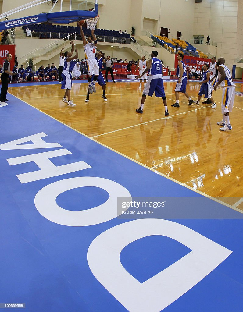 Lebanese al-Riyadi player Fadi el-Khatib (C) jumps for the ball during their match against Saudi Arabia's al-Hilal club in the 21st FIBA Asia Champions Cup at the al-Gharafa indoors stadium in Doha on May 24, 2010. Riyadi won 83-77.