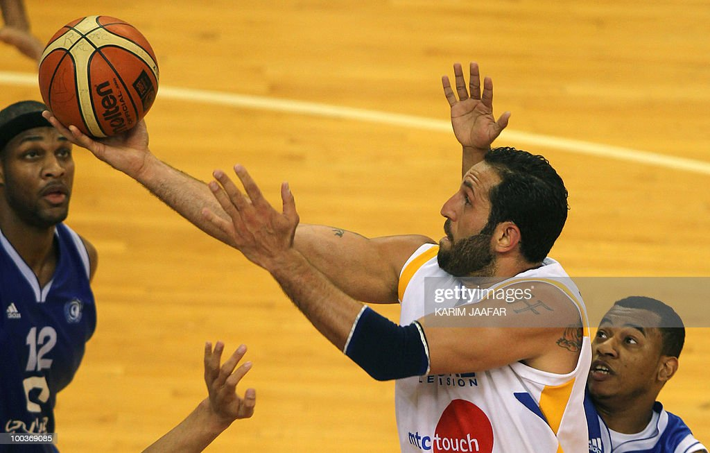 Lebanese al-Riyadi player Fadi el-Khatib (C) reaches to snatch the ball against Saudi Arabia's al-Hilal club players American Brandon Christopher (L) and an unidentified player during the 21st FIBA Asia Champions Cup at the al-Gharafa indoors stadium in Doha on May 24, 2010.