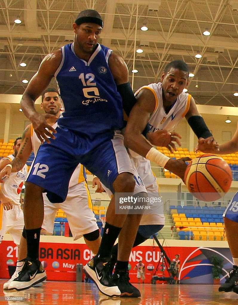 Lebanese al-Riyadi player Hussein Tawbe (R) vies for the ball against US player Brandon Christopher Crump (L) of Saudi Arabia's al-Hilal club during the 21st FIBA Asia Champions Cup at the al-Gharafa indoors stadium in Doha on May 24, 2010.