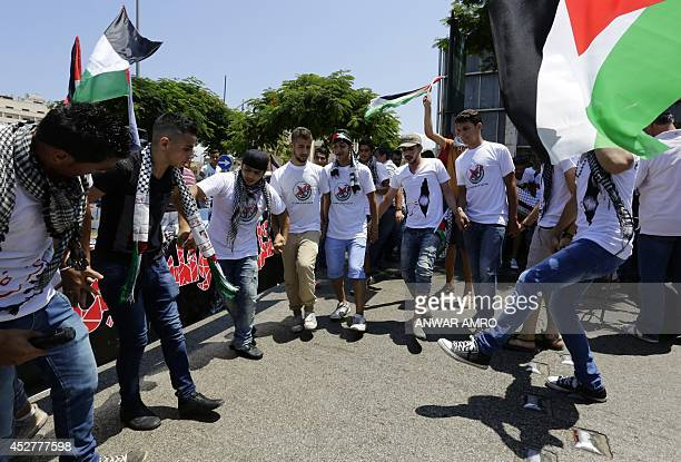 Lebanese and Palestinian protesters dance the Dabke a popular Arabic folk dance as they wave the Palestianian flag during a demonstration in support...