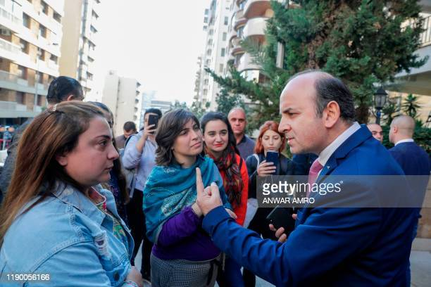 Lebanese anti-government demonstrators argue with a representative of the popular movement , outside the home of Lebanon's prime-minister designate,...