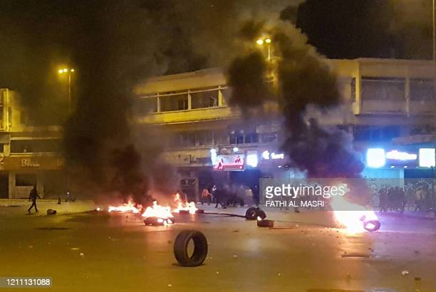 Lebanese anti-government protesters burn tyres amid clashes with security forces in the northern city of Tripoli late on April 27 following a...
