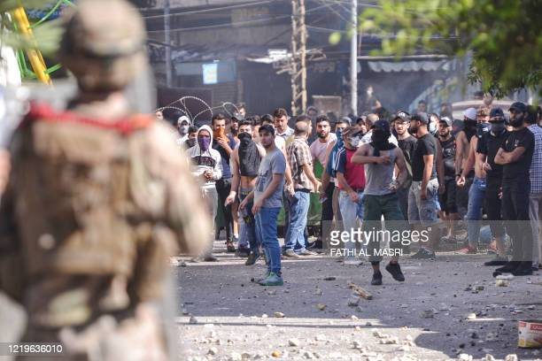 Lebanese anti-government protesters clash with soldiers in the Bab al-Tabbaneh neighbourhood in the northern port city of Tripoli, on June 13 on the...
