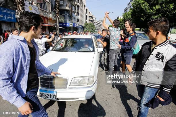 Lebanese antigovernment school students demonstrate in the streets of the northern port city of Tripoli on November 6 2019 Hundreds of schoolchildren...
