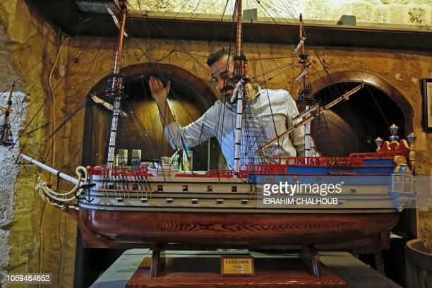 Lebanese architect Ghassan Bakri looks at his work titled La Licorne a replica of the ship from the Belgian comic Tintin that he finished after seven...