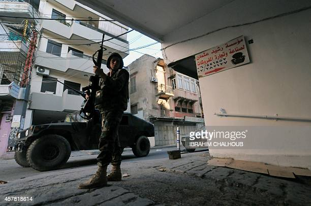 Lebanese armed forces patrol a street on October 25 2014 in the historic area of the northern city of Tripoli where clashes erupted the day before...