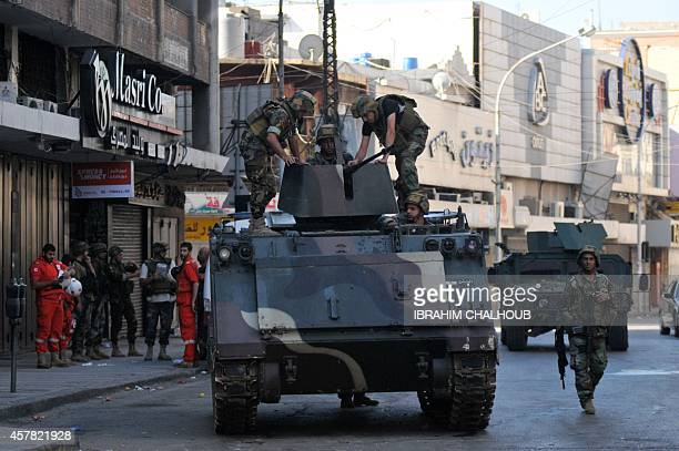 Lebanese armed forces stand on an armoured personal carrier during an assault on Islamist gunmen's makeshift positions inside a historic area of the...