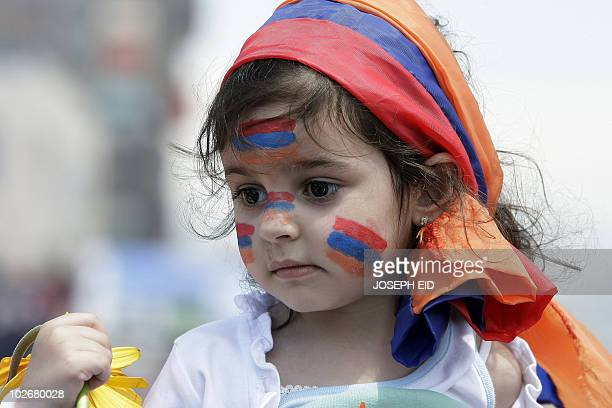 A Lebanese Armenian girl wears the Armenian flag on her head during a rally in Beirut on April 24 2010 to mark the 95th anniversary of mass killings...