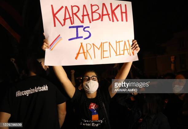 Lebanese Armenians demonstrate outside the Turkish embassy in Rabieh, on the outskirts of Beirut, on October 26 to protest against the fighting...