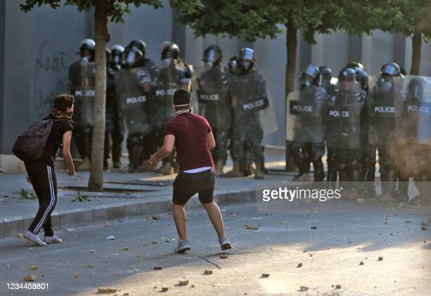 Lebanese army and security forces clash with demontrators near the parliament in downtown Beirut on August 4 on the first anniversary of the blast...