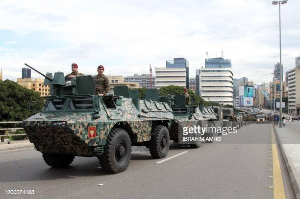 Lebanese Army forces secure an area where demonstrators gathered in the heart of Beirut on February 11 to stop a confidence vote for a new government...