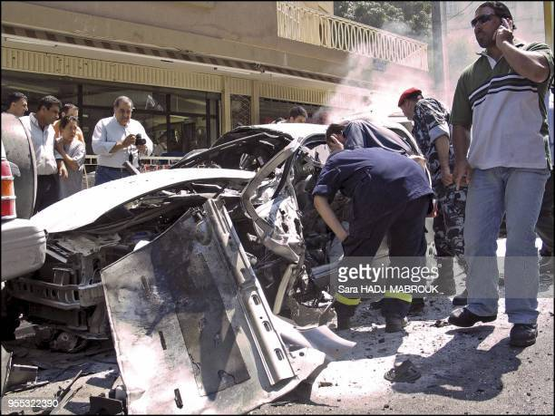 Lebanese army officers surround the destroyed car of slain Lebanese journalist Samir Kassir following an explosion in Beirut Kassir known for his...