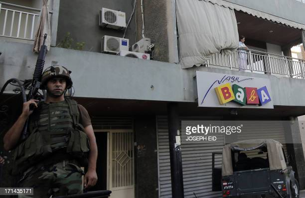 A Lebanese army soldier monitors as they perform search operations in the Abra district of the southern Lebanese city of Sidon on June 24 2013 At...