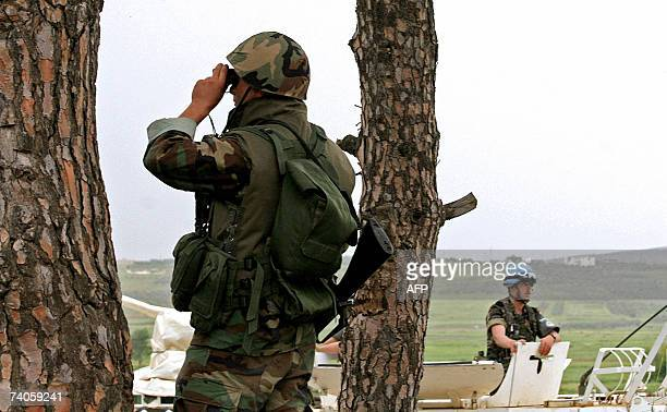 Lebanese army soldier scans the area during a militray exercise with UN Spanish peacekeeping soldiers in the southern Lebanese village of Kfar Kila...
