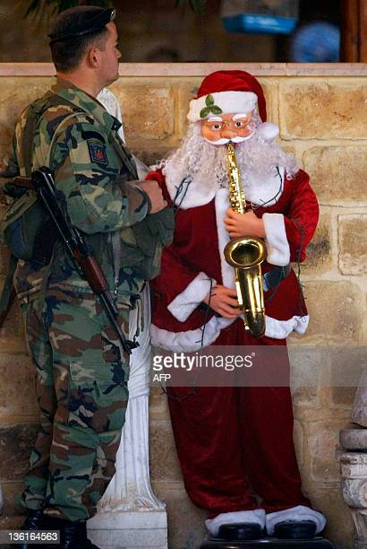 A Lebanese Army soldier secures the entrance of the restaurant which was rocked by an explosion early December 28 2011 in the southern Lebanese city...